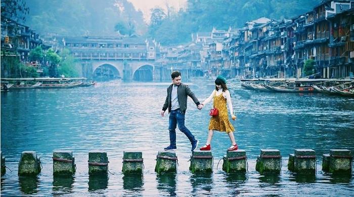 Chiêm bao thấy cùng người lạ đi du lịch Trung Quốc